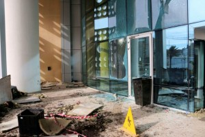 Damaged doors are seen at the Corinthia Hotel, where gunmen blew themselves up after storming it, in Tripoli